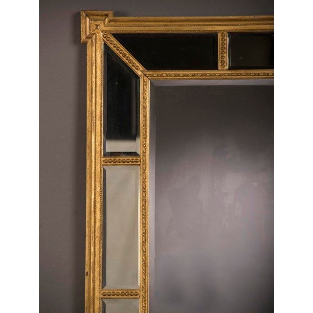 A handsome gold leaf frame in the manner designed by famed English architect Robert Adam that encloses the mirror glass from England c. 1895 For Sale - Image 4 of 6
