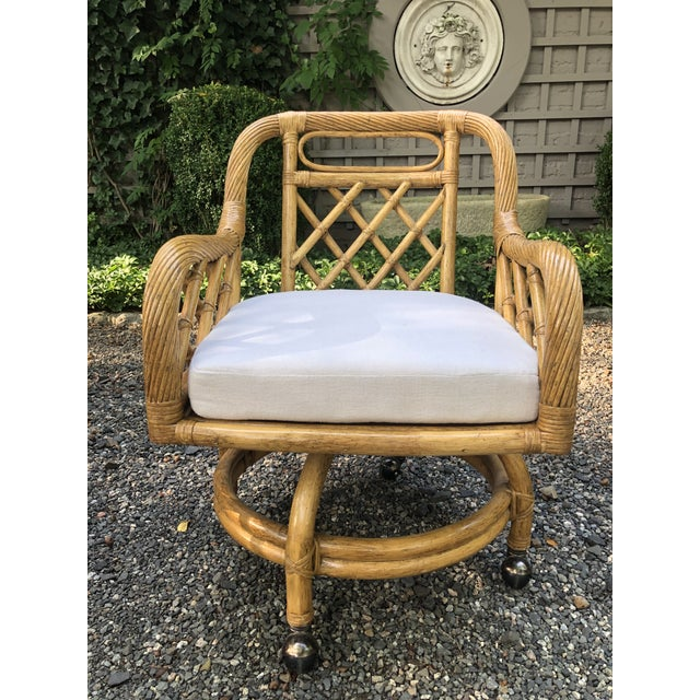 Fabulous set of six mid-century rattan swivel dining chairs on casters in the style of Franco Albini. Each chair has an...