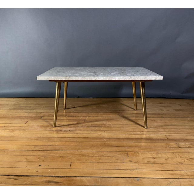 """Classic medium-size Mid-Century American coffee table with a 32"""" x 23"""" rectangular top of Italian Travertine over..."""