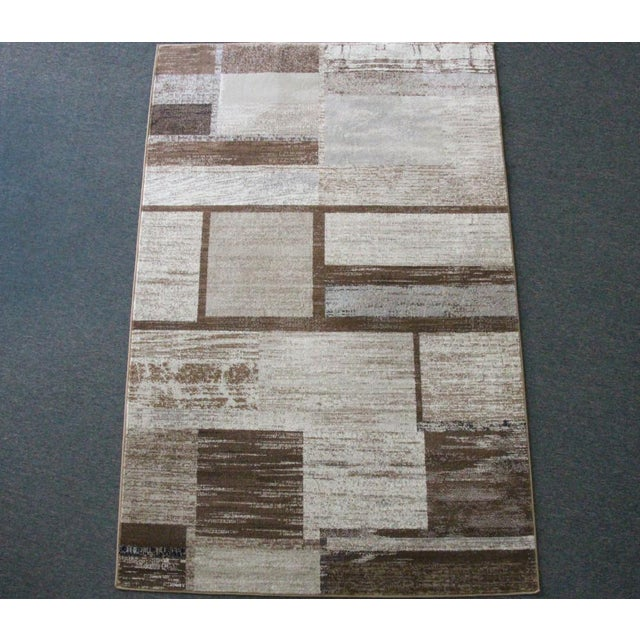Versatile, eclectic and stylish, this Versatile Neutral Rug in Brown is sure to soften stronger lines and pull any room...