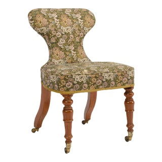 19th Century Irish Mahogany Upholstered Chair with Brass Casters For Sale