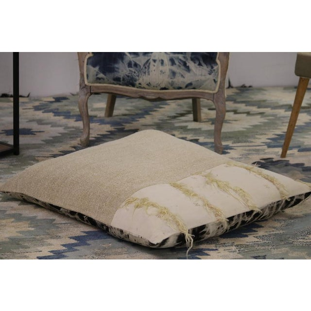 Floor Pillows are a popular way to help define seating areas in larger rooms. The contemporary style of this custom...
