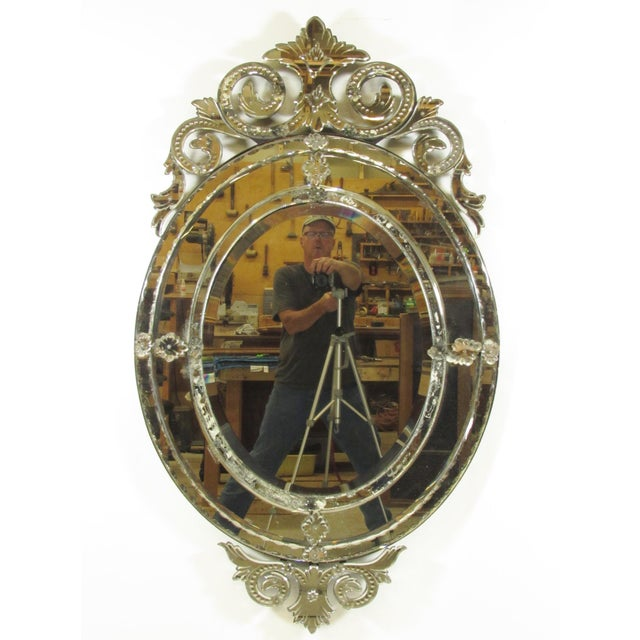 An early large 20th century Venetian oval mirror framed mirror with elaborate leaded cut glass detail and trim. Minor loss...
