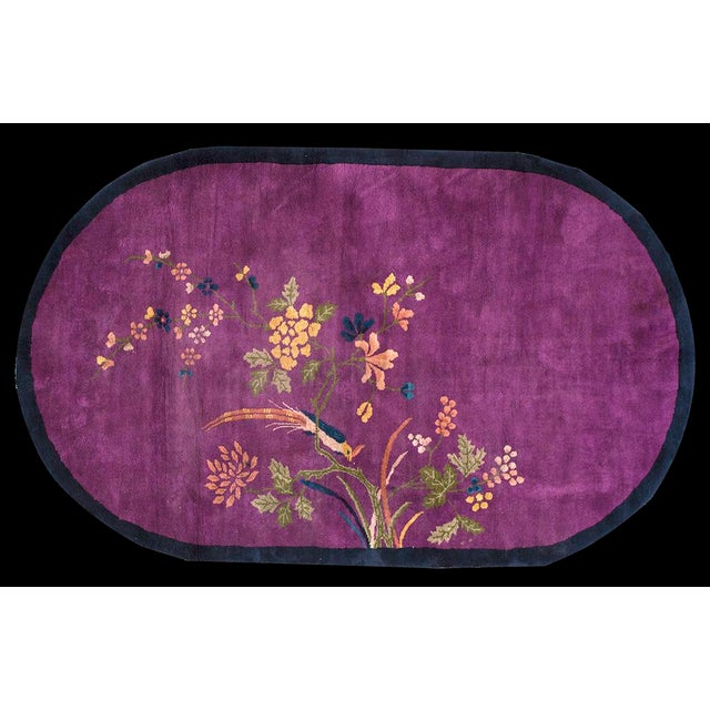 """This is a Chinese art wool rug from China 1920. The size is 6'10""""x4'3"""". The colors are purple, blue, cream, and pink...."""