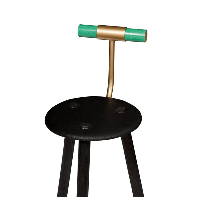 Charred ash tripod stool with lacquered ash backrest and satin brass supports. Designed by Ben Erickson for Erickson...