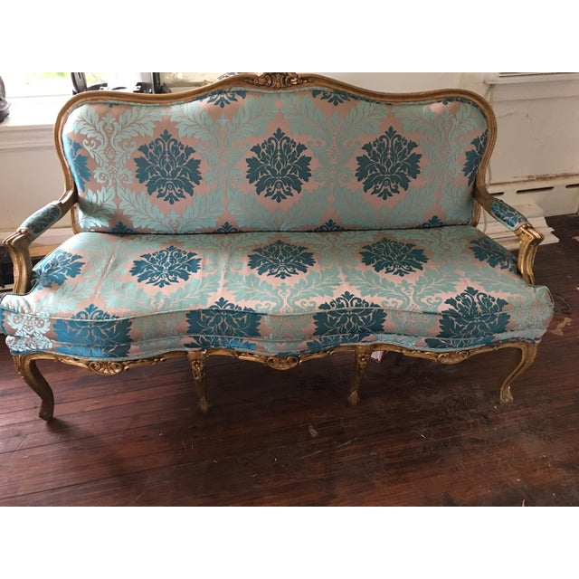 Beautifully restored, vintage settee. Peacock and azure damask. Crushed blue velvet fabric backing.