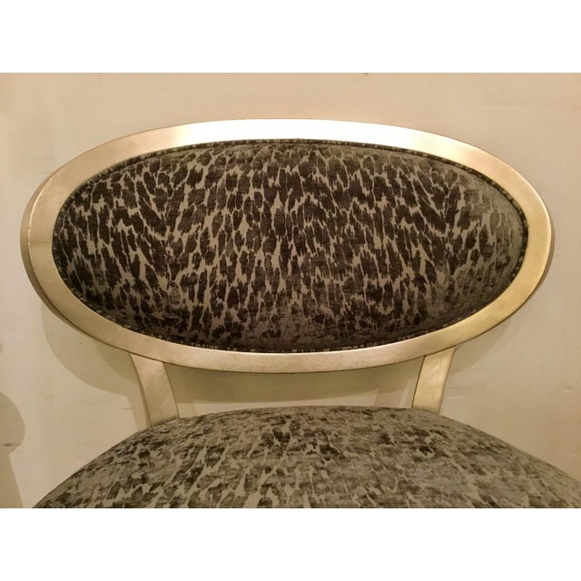 Chic modern Currey & Co. Bacall Chair, elegant champagne frame upholstered in a dueling charcoal and light gray cut velvet...