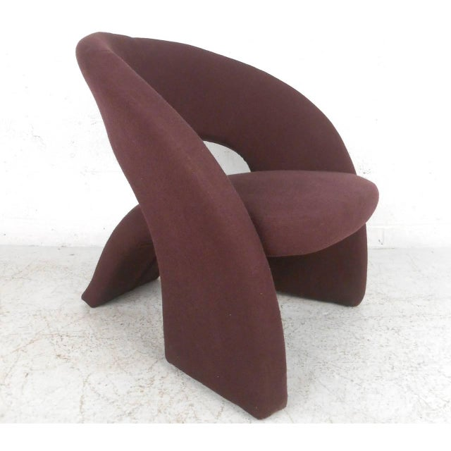 This unique matching chair and ottoman combine flowing lines with comfortable and stylish design. Unique shape adds...