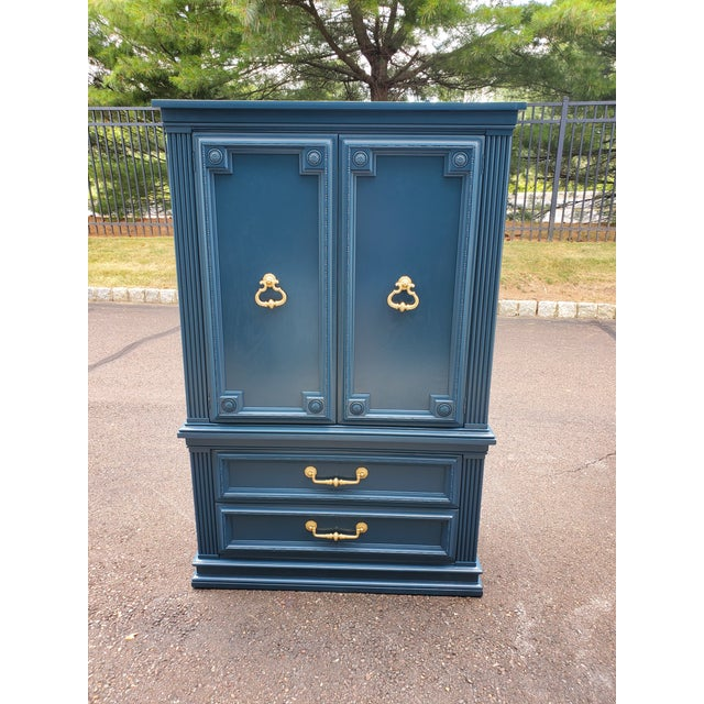 Beautiful vintage Armoire painted Moscow Midnight. The hardware is gold. Drawers and doors function perfectly. This is...