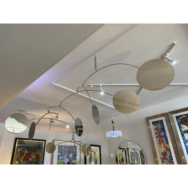 This large scale nickel plated mobile was designed by Iconic Snob Galeries and has graced the Patio Archway of a Palm...