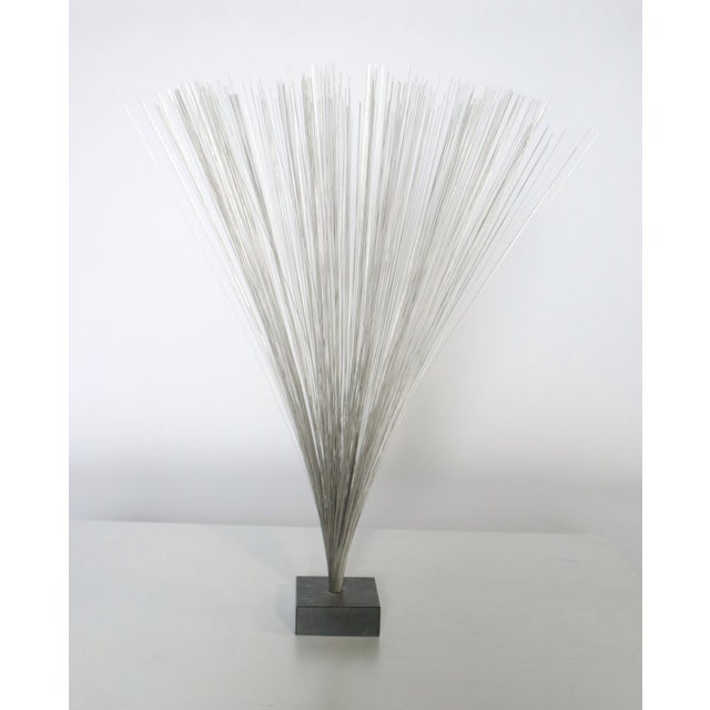 "Tall Harry Bertoia style metal rod spray sculpture on a slate gray plinth. 35"" H and sprays out to 26"" dia. plinth..."
