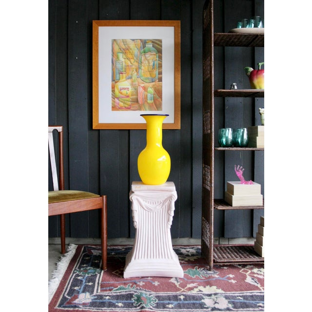 Soft pink plaster faux draped pedestal. This piece is versatile and can act as a plant perch, side table, or base for a...