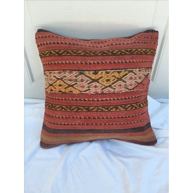 Offered is a custom pillow made from a fragment of a vintage, handwoven kilim rug purchased from the Grand Bazaar in...