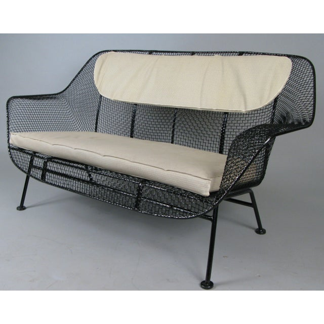A 1950s wrought iron and steel mesh settee from Russell Woodard's iconic Sculptura series. Beautiful and Classic...