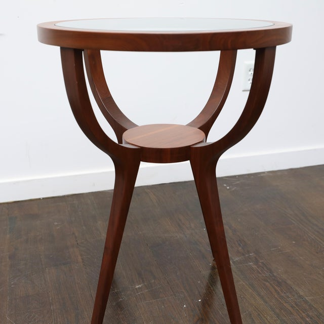 Very close in style to the Halabala deco-era tables. With band new glass and a perfectly refinished walnut frame, this...