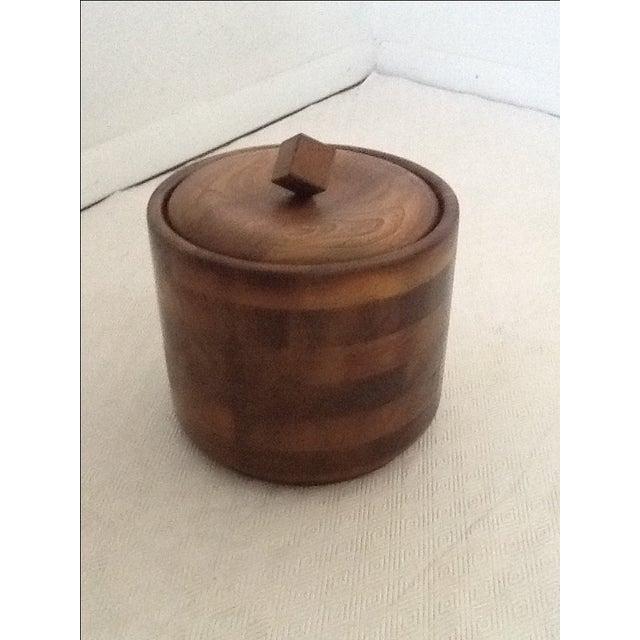 Mid-Century walnut ice bucket with mercury interior lining. Heavy, good quality.