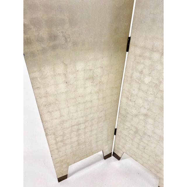 Four Paneled Silver Foil Folding Screen with metal capped feet. Shell swirl design on both front and backs of panels on...