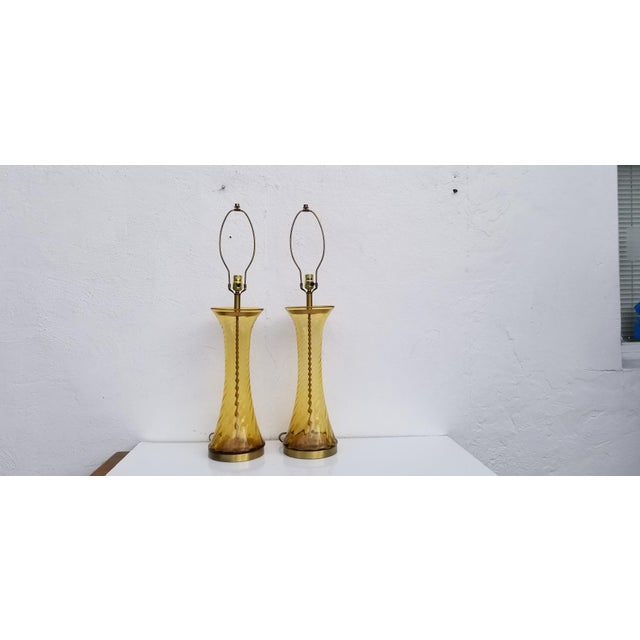 Tall beautiful vintage Hollywood Regency amber glass with brass lacquer base decorative Table lamps a pair. Dimensions:...