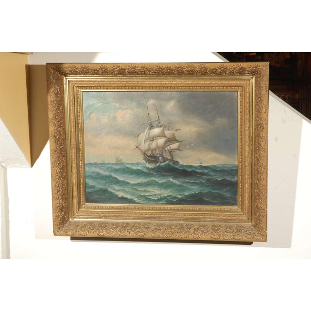 19th century American oil painting on canvas of a ship at sea. Signed (Illegible) with original gold finish wood and...