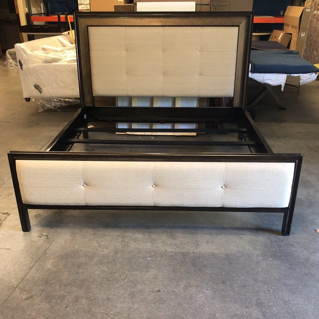 This hickory white features a wood frame with a tufted linen footboard and headboard. It has a gold accent inlay bordering...