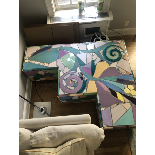 This mosaic stone table was purchased from 1stDibs, it is a gorgeous complement to any stylish room. It is unique,...