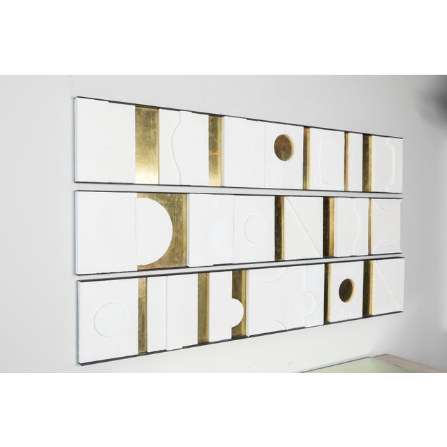 Modernist frieze of architectural decorative art wall panels with brass and gesso relief. Each panel of this triptch is...