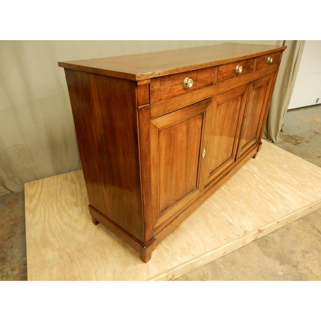 Carefully restored walnut 19th century Directoire' style French endilade. It has three drawers and three doors Very nice...
