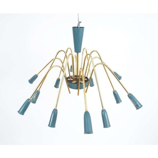 Beautiful 38 inch chandelier featuring 12 shiny alternating brass arms and bulbs. The bulb tubes have a light blue color....