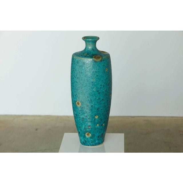 Beautiful large Italian modern ceramic fat lava glaze vase in turquoise blue with golden sunbursts by Guido Gambone....