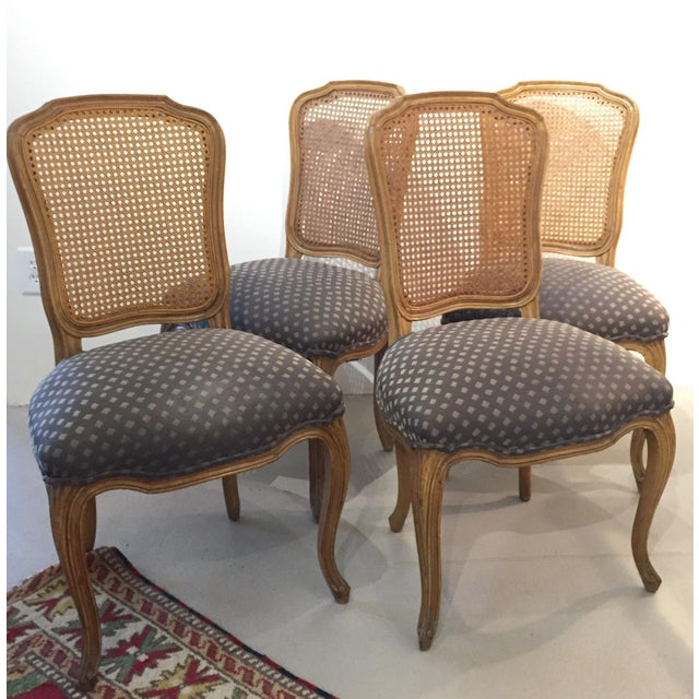 """Beautiful and high quality set of four cane-back chairs with upholstered seats. Seat is 18"""" high. All caning is in..."""