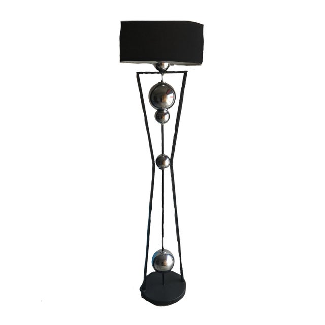 This wonderful 50s- 60s style floor lamp has an amazing form well executed in chrome and black with black oval shade...