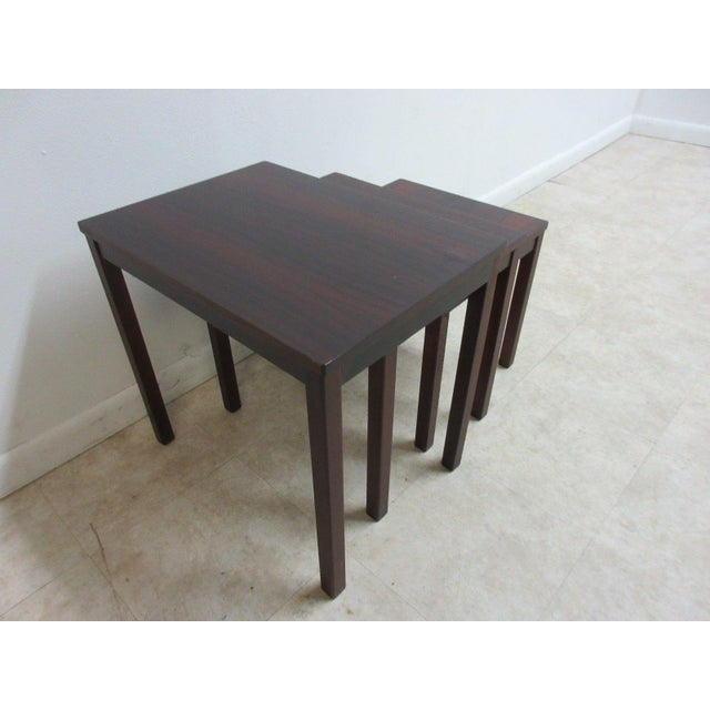 A vintage Danish modern rosewood nesting table set. Great shape. Tight and sturdy.. Minor finish wear and rub marks....