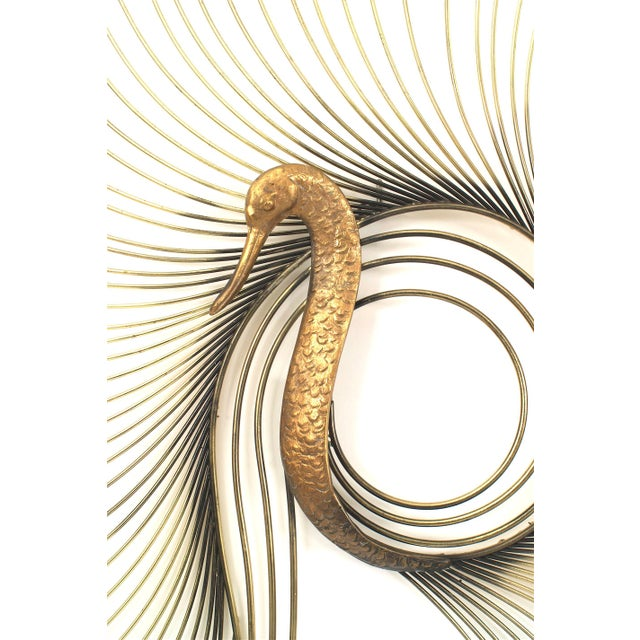 American midcentury (1980s) large wall sculpture in the form of a peacock with brass feathers and a copper bird head...