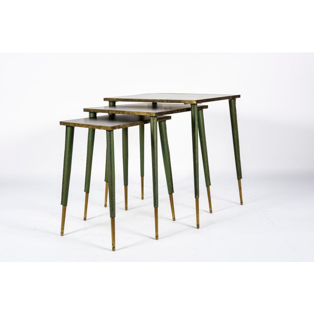 Very rare stitched leather nesting tables Very good condition Each table measures:: 34 x 45 x 46 cm 34 x 34 x 44 cm 23 x...