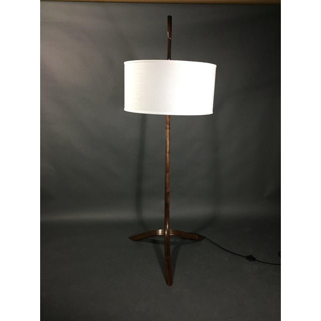 Master craftsman, Daniel Oates created this gorgeous standing lamp in solid walnut that he personally steam-bent in his...