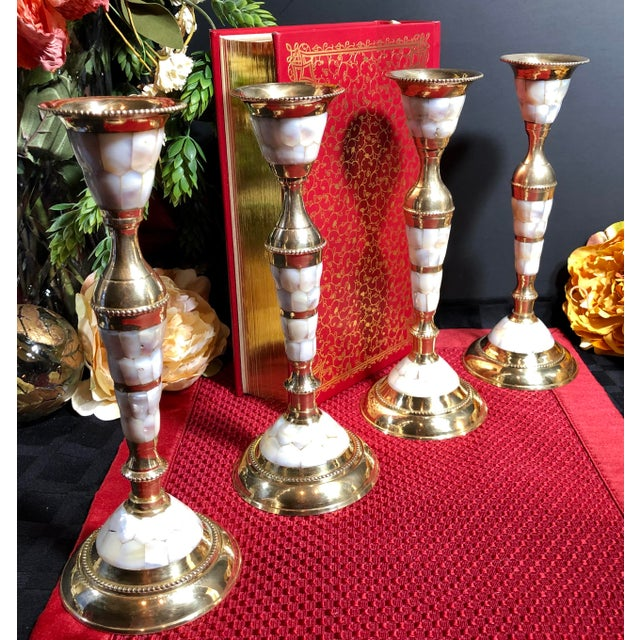 This is for 4 matching candle sticks with brass and mother of pearl. They were made in India and come with the original...