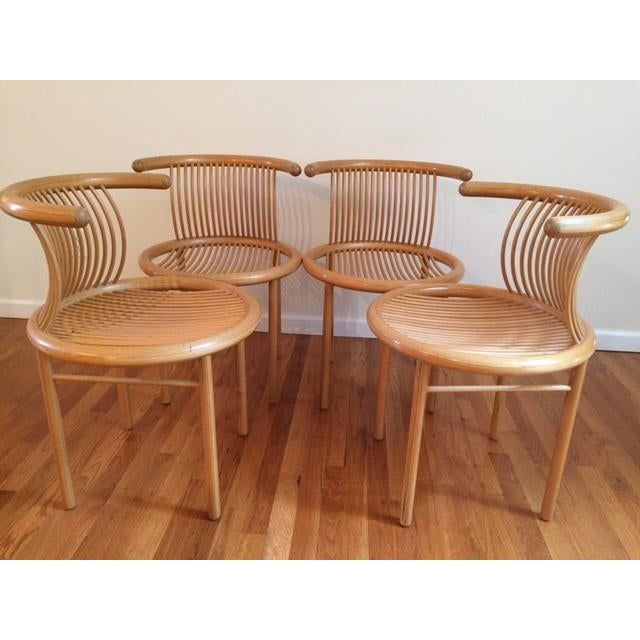 This is a rare set of 4 Mid-Century Modern Helmut Lubke Natural finish dining chairs made in Germany. They were designed...