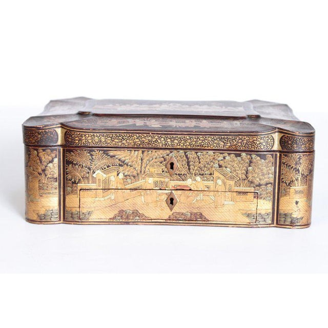 A beautifully executed black lacquer sewing box made for the English market. The rectangular shaped box has gilt...