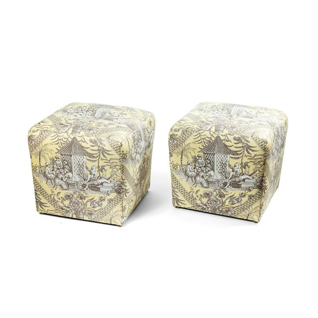 Vintage pair of ottomans covered in a Manuel Canovas toile fabric.