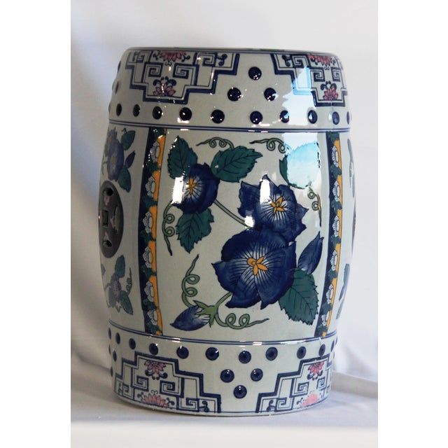 This listing is for a classic blue and white garden stool. This piece features a floral motif.