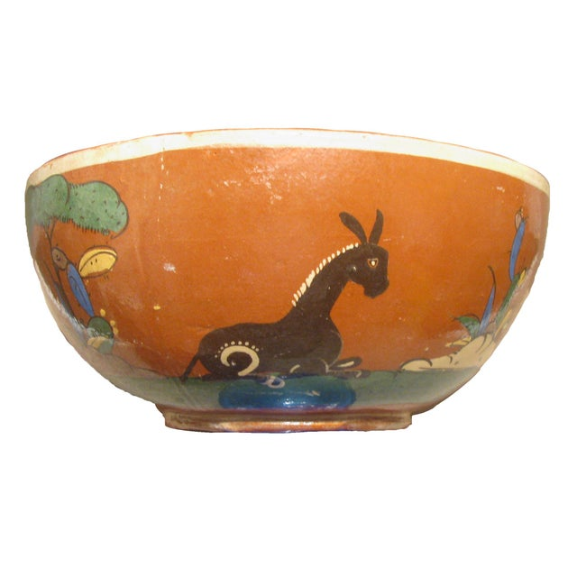 Vintage Mexican redware bowls in graduated sizes. Whimsical and colorful hand painted scenes of a burro, cacti, flowers,...
