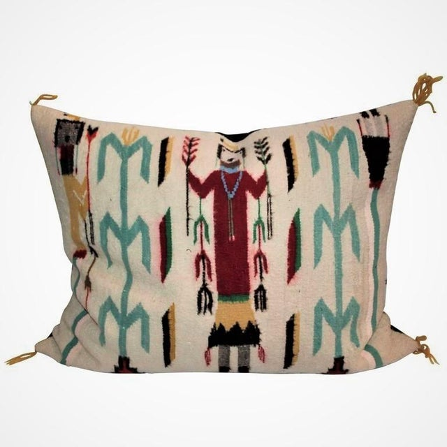 This large Yea Indian weaving bolster pillow has a black cotton linen backing. Colorful and folky.