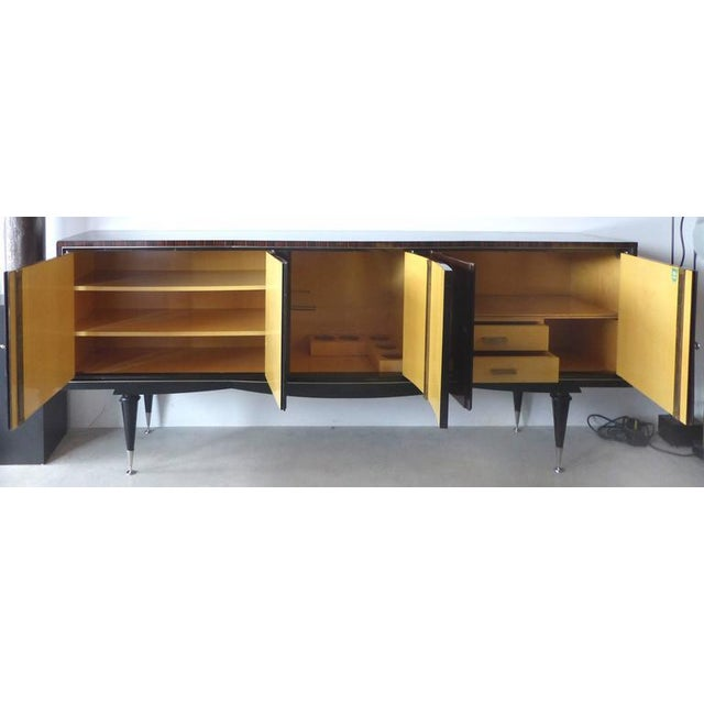 A fine quality French Art Deco Credenza with richly grained Macassar ebony credenza with nickel-plated hardware. Five...