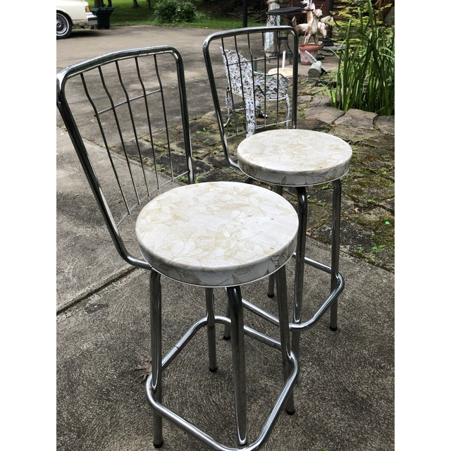 Mid Century pair of chrome swivel bar stools. Narrow set of unique stools for any area in your home. Vinyl seats are...