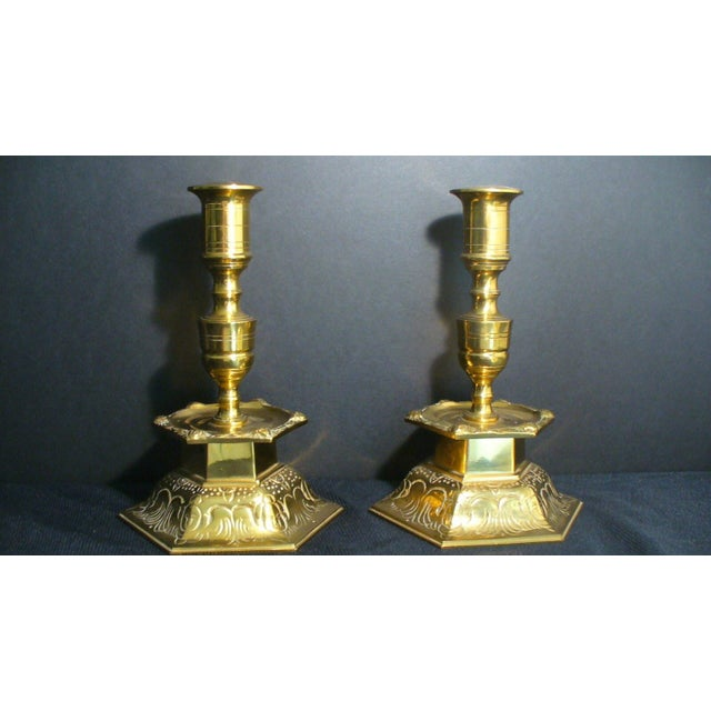 A pair of Ystad Metall Candleholders, made in Sweden from solid brass. They feature incredible scrolling and intricate...