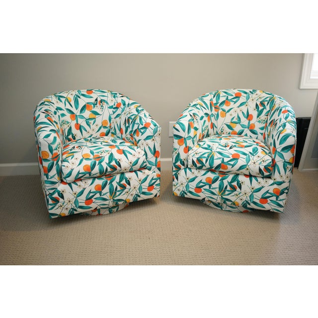 Really cute small swivel chairs with a plinth base. They are in the style of milo baughman. I reupholstered them with this...