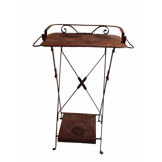 This weathered Anthropologie plant stand would make any garden complete. It features an even patina and a convenient...