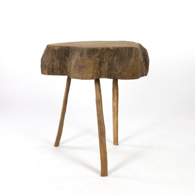 An unusual 19th century Scandinavian three-legged primitive butcher block table with wonderfully worn amorphously-shaped...