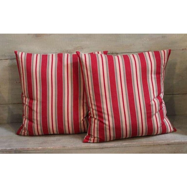 This pair of red, tan and gray pillows are made from 19th century ticking and are in pristine condition showing...