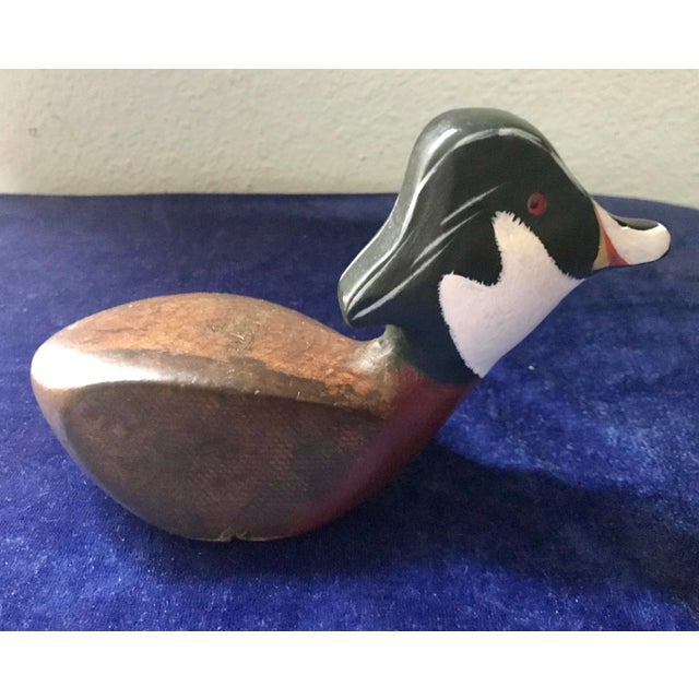 This is a vintage hand carved duck from a Brassie golf club head. Nicely done, beautiful would and hand painted. Vintage...